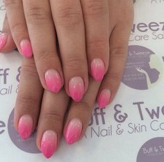 Nude/pink ombrè short pointy tip nails.