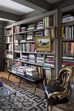 Moody, dark and lovely... a library that reflects the gentle madness of its voracious reader.