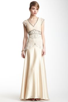 "V-Neck Shirred Beaded Trim Gown in champagne by Sue Wong $480 - $165 at HauteLook. - Padded, shirred bustline - Concealed side zip closure - Beaded sequin waistline - Sheer beaded overlay - Approx. 60"" length Fit: this style fits true to size.  Model's stats: - Height: 5'8"" - Bust: 34"" - Waist: 24"" - Hips: 34"" Model is wearing size 4. Spot clean Self: 70% nylon, 30% polyester Lining: 100% polyester"