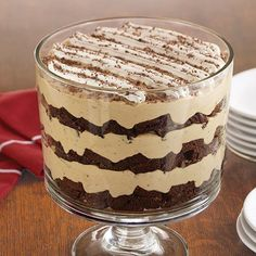 Coffee liqueur makes a bold statement in this dramatic dessert. If desired, use our nonalcoholic variation, as shown in our Cook's Tip. Tiramisu Brownie Trifle Tiramisu Brownie Trifle - The Pampered Chef® (we used Kahlua for the coffee liquor) Trifle Bowl Recipes, Trifle Desserts, Pudding Desserts, Just Desserts, Delicious Desserts, Yummy Food, Dessert Trifles, Layered Desserts, Gourmet Desserts