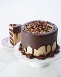 [New] The 10 Best Food (with Pictures) - Coffee layer cake This Four layers of chocolate buttermilk cake filled with a coffee buttercream & topped with a chocolate ganache and a sweet caramel! For order - dm us or call 9549060262 Cakes To Make, How To Make Cake, Chocolate Toffee, Homemade Chocolate, Chocolate Cake, Mini Cakes, Cupcake Cakes, Cupcakes, Coffee Buttercream