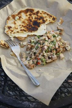 Guam-Style Chicken Salad: Marinated in cane vinegar and soy sauce, this succulent grilled chicken salad gets a dose of sweetness and heat from coconut and chiles.