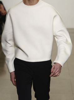 jil sander: shoulder line falling beyond the shoulder blades, sleek/sharp cuts