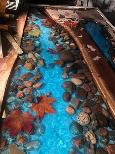 Live edge River table with stones and leaves walnut Diy Resin Table, Epoxy Wood Table, Woodworking Crafts, Woodworking Plans, Sol 3d, Home Crafts, Diy And Crafts, Resin Furniture, Furniture Ideas
