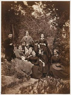 Possibly knitted/crocheted shawl (woman standing in middle back)