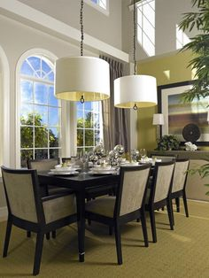 See how two modern chandeliers illuminate a long table with seating for eight in this transitional dining room on HGTV.