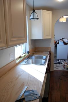 We also researched a sealer that would dry to a non-toxic finish (food safe) and make these countertops sturdy enough for a family of six–enter Waterlox Marine Sealer.