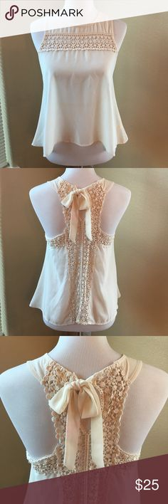 Monteau Sheer Lace Tank Like NEW Condition! Beautiful sheer Lace Tank by Monteau. Size Medium. Ties behind the neck to adjust fit. Flattering, flow-y fit. Perfect layering piece to dress up your outfit. Reasonable offers welcome. 20% off bundles! Monteau Tops Tank Tops