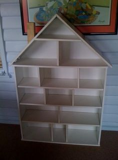 large dolls house made from ikea book case and extra shelves