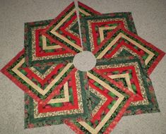 Quilted Christmas tree skirt, crazy 8 strip pattern.  converted and made by naomi s