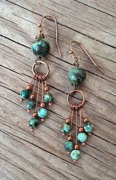 Funky, artsy, eclectic turquoise and copper earrings. Copper dangles with African turquoise beads hang from a larger turquoise bead. Very light weight and rich in blue/ green tones. #fbloggers #lbloggers #cbloggers