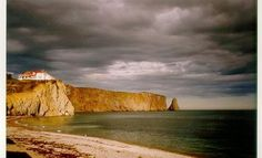 Rocher percé on a cloudy day in Gaspesie, Quebec