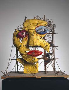 """Jean Tinguely (22 mai 1925 - 30 août 1991). Célèbre pour ses sculptures-machines, construites avec des matériaux de récupération auxquels il redonnait vie en utilisant des moteurs. """"Le Cyclope - la Tête """", 1970"""