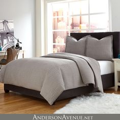 The Trent 3 Piece Duvet Set by Michael Amini Bedding features a neutral gray color and an elegant croc quilted design.  This luxurious duvet set is substantial enough to use alone yet neutral enough to pair with other bedding accents.  It is available in King and Queen Sizes.