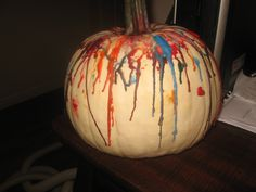 Let your kids melt crayons on a white pumpkin! Safe and fun for all ages. Just unwrap crayons, break in half and lay in different places on the pumpkin. Make sure you do it out side because it can get messy. Use a blow dryer on HOT and watch the kids have a ball :) Happy Halloween!