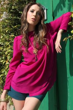 The gorgeously draped Grace top in magenta is constructed out of 100% vintage silk crepe and features a dramatic capelet on the shoulder. Also available in black or blue print. Eco friendly and made in the USA. #ecofashion #ecofriendly #sustainable