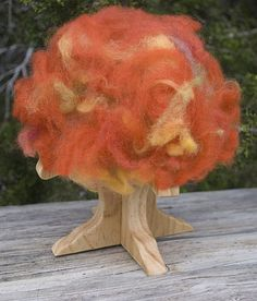 love this idea~ wooden tree adorned with seasonal roving