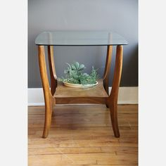 I love this side table, I would love to plant a succulent garden in it too! or maybe a pretty indoor bonsai?