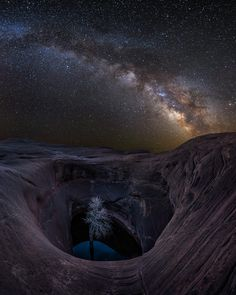 "Life in the Void by Jared Warren on 500px  In a remote area of the Colorado plateau is a fascinating expanse of undulating sandstone punctuated with dozens of ""potholes,"" some more than 50 feet deep.   I particularly love being out under the stars in such surreal locations. It's both humbling and exhilarating staring up at our Milky Way and realizing our solar system is one of billions in our galaxy, which itself is just one of billions of galaxies in the cosmos. Quite a lesson in…"