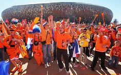 You can't miss Dutch fans at sporting matches. (Holland v Denmark: World Cup Group E match)