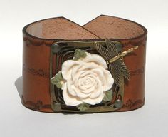 Leather Cuff white rose an dragon fly. $40.00, via Etsy.