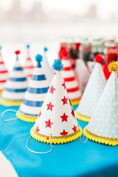 Fun party hats: http://www.stylemepretty.com/living/2015/03/23/brooklyn-carousel-first-birthday-party/ | Photography: Nicki Sebastian - http://www.nickisebastian.com/