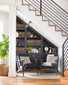 Under stairs bookshelf with cabinets
