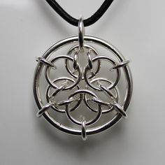 Pendant with big ring of 2mm silver thread. The pattern inside the ring called Acute Mandala. silver 925
