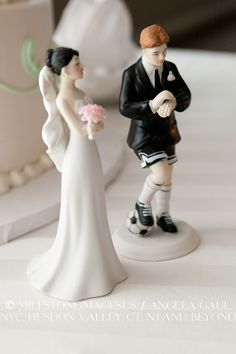 Humorous cake topper with soccer-playing groom, but I would definitely be the one with the soccer ball