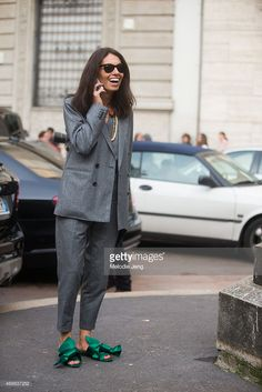 Stylist/Editor Viviana Volpicella exits Salvatore Ferragamo in wears a Dsquared2 suit and NumeroVentuno N21 shoes on Day 5 of Milan Fashion Week FW15 on March 1, 2015 in Milan, Italy.