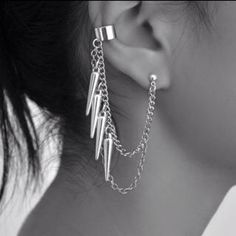 Ear cuff with multiple dangles.