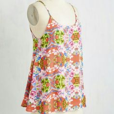 """FINAL PRICE! Flowing Flower Spaghetti Strap Tank Beautiful vibrant pattern, great for Spring and Summer, 25"""" in length, shell is 100% Rayon, lining is 100% Polyester. Shell fabric has no stretch, lining does stretch. Hand wash. Will fit a size 2-4 ModCloth Tops Tank Tops"""