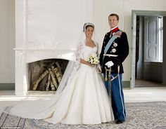 Spectacular: For her 2008 wedding toPrince Joachim of Denmark, Count of Monpezat, Marie Cavallier, a former advertising executive, wore a stunning Calais lace gown byDavid Arasa and Claudio Morelli and a floral tiara lent by the Scandinavian nation's Queen Margrethe
