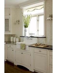 Pretty Farmhouse Kitchen. Molding above window
