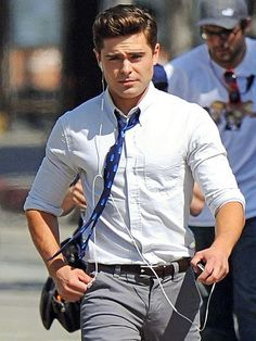 He's a man on the move! Zac Efron stays connected while hustling to the set of his latest film, Townies, in L.A. http://www.people.com/people/gallery/0,,20688280,00.html#21304119