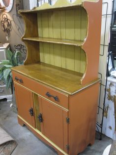 Antique hutch redone in adobe red and yellow with antiquing detail (love this piece!!)