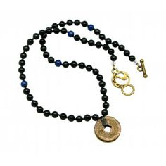 Energy Muse Protection Necklace; The human body is constantly bombarded with positive and negative energies. Our Protection piece focuses on creating a shield against harmful energy. Once introduced to your energy field, Black Onyx works to repel negative vibrations. Lapis Lazuli has been added to encourage total awareness and support a state of attentive serenity.