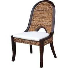 Perfect for farm-fresh suppers with your family or elegant dinner soir�es, this design offers chic style for your home.   Product: Dining chairConstruction Material: Abaca weaveColor: Natural and brownFeatures: Cushion includedDimensions: 40.25 H x 23.5 W x 25.25 D