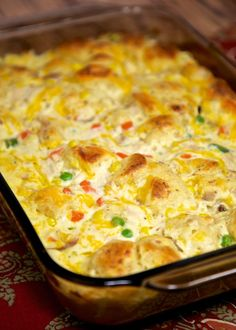 Chicken Pot Pie Bubble Up Recipe - chicken, chicken soup, sour cream, cheese, frozen vegetables and biscuits. A whole meal in one pan!
