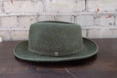 Check out this item in my Etsy shop https://www.etsy.com/listing/499215676/vintage-green-fedora-wool-louis