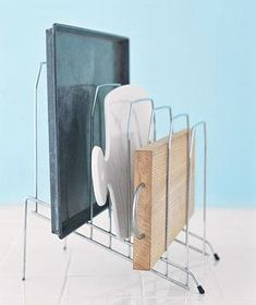 14. Use a desk organizer to store cookie sheets and cutting boards.