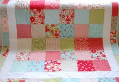 For a baby girl...THIS is it.  :)  Baby Quilt - Moda Ruby - Patchwork Quilt - Baby Blanket - Modern Baby Quilt - Quilted Blanket. $125.00, via Etsy.