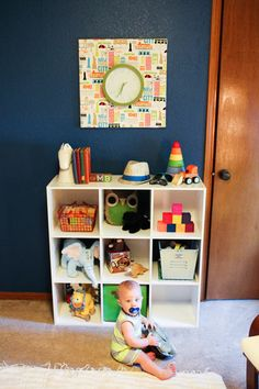 Alayna's Nursery Tour - Deep colors, bright patterns and vintage travel theme.  Storage and bright art.