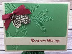 This Chrsitmas card uses Stampin' Up!'s Chrstmas Pines stamp set and Pretty Pines Thinlits Dies (bundled together for a discount!).  It also uses the new Mini Pinecones and the Gold Baker's Twine.  The embossing folder is the new Pine Bough.  #stamptherapist #stampinup  www.stampwithjennifer.blogspot.com