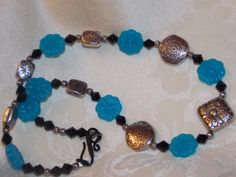 Blue Flower Necklace by EriniJewel on Etsy, $20.00