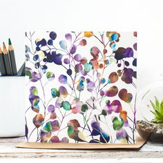 Illustrated gift card featuring 'Botanica' abstract floral pattern design in rich hues of purple, blue and ochres. By Jessica Wilde Design ©