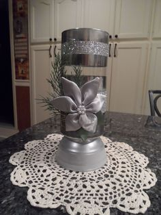 Dollar store vase decorated in gold or silver. Very pretty holiday decoration.