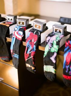 My husband is a comic book fanatic and gifted his groomsmen with superhero socks for the big day