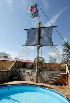 pirate ship next to the pool. With a plank for the diving board and rigging they could climb and jump off of into the pool