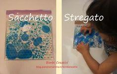 Il Sacchetto Stregato è una busta magica che permette di disegnare e manipolare il contenuto facendo unire e dividere le gocce ivi contenute